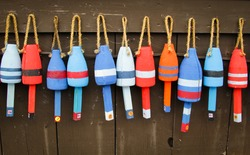 Colorful buoys on a wall of a shack in Maine, USA