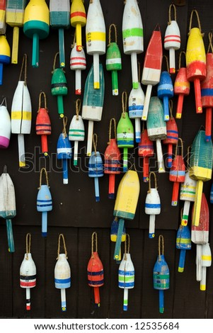 colorful buoys on fisherman's house in coastal Maine