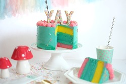 Colorful cake slices and cupcakes on white festive table
