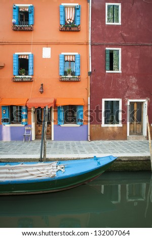 Colorful canal, boat and houses, Burano, Italy - stock photo