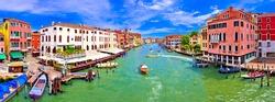 Colorful Canal Grande in Venice panoramic view, tourist destination in Veneto region of Italy