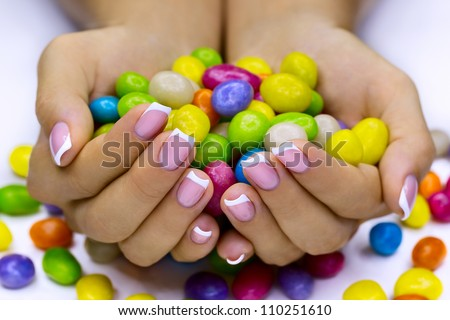 Colorful candies in woman's hands