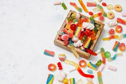 Colorful candies, jelly,marshmallow on light background. Top vie
