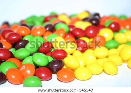colorful candies on a white background.