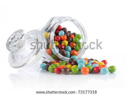colorful candies over white background