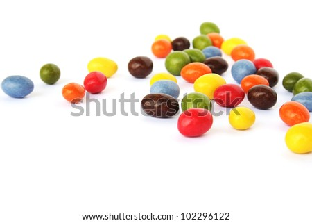 Colorful candies with raisins and peanuts  isolated on white background.