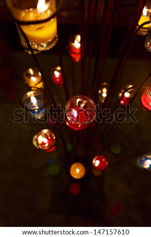 colorful candles in the glass