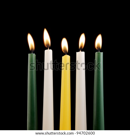 Colorful candles isolated on black background