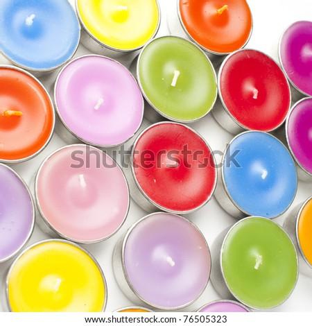 Colorful candles on white background