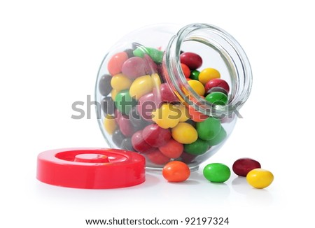 colorful candy in glass bottles isolated on white background