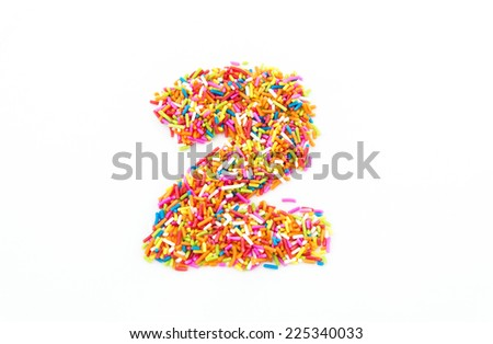 Colorful candy sprinkles number two isolated on white background
