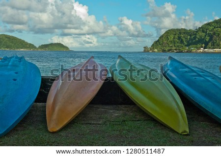 Colorful canoes on the beach in Pago Pago, Tutuila, American Samoa.