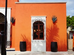 Colorful caribbean closed orange building, business in Mexico.