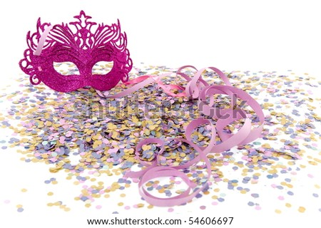 Colorful carnival mask, confetti and streamers .