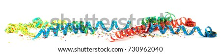 Colorful carnival ribbons with confetti against white background Foto stock ©
