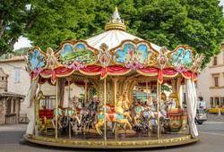 Colorful Carousel Attraction Ride With Wooden Horses in an Italian Village