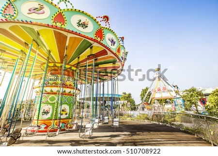Colorful carousel in attraction park