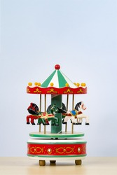 colorful carousel toy in white background. Vertical