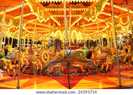 colorful carousel with lights at night