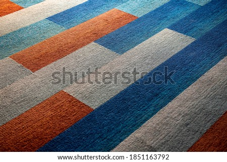 Colorful carpet floor texture background. Interior luxury design in an office, living room and hotel. Selective focus. Foto d'archivio ©