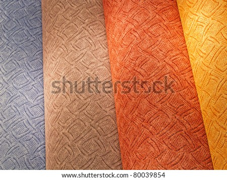 colorful carpet samples on the shelves