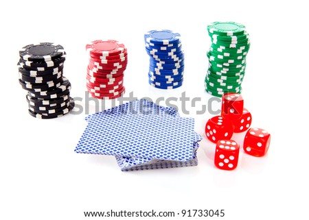 colorful casino chips, carts and dices over white background