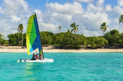Colorful catamaran on azure water against azure water