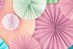 Colorful celebration background wall with multicolored paper circles of pink, beige, yellow