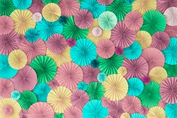 Colorful celebration background wall with multicolored paper circles of pink, lilac, yellow, green and blue colors
