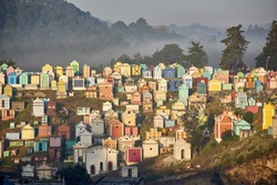 Colorful Cemetery in Chichicastenango , Guatemala - the picture from February 3rd 2016 shows the famous Chichicastenango cemetery where family members paint the tombstone
