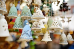 Colorful ceramic bells and other decorations sold on Christmas market in Riga, Latvia.