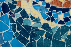 Colorful ceramic mosaic floor or wall. mosaic top view. Bathroom or kitchen floor wall design idea. Reused broken tile. Interior design. Colored eastern pottery.