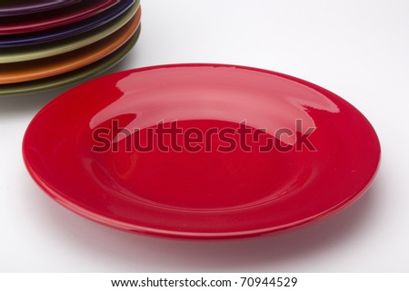Colorful ceramic plates for the main dishes. - stock photo