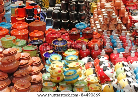 Colorful ceramic pots and utensils displayed for sale