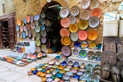 Colorful ceramic souvenirs for sale on the street in a shop in Morocco