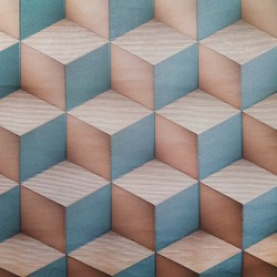 Colorful ceramic tile  with volume cube pattern for wall and floor decoration. Concrete stone surface background. Volume texture with     3 d geometric ornament for interior design project.
