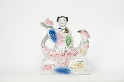 Colorful ceramic traditional chinese ancient girl and swan mythical creature statue on isolate white background / Symbol of lucky and prosperity for chinese and asian sculpture