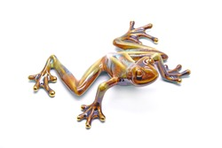 Colorful ceramic tree frog, isolated on white background.