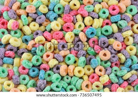 Colorful cereal loop rings, breakfast food background #736507495