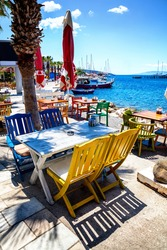 Colorful chairs and white table at seaside restaurant in Bodrum, Turkey