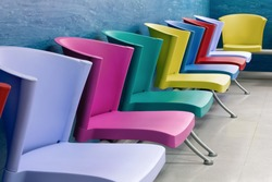Colorful chairs lined up in a school child