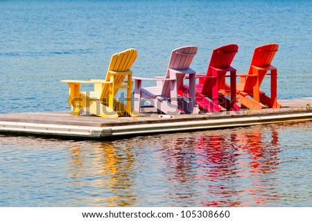 Colorful chairs on a dock