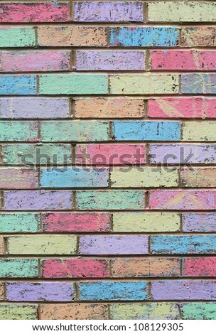 Colorful chalk wall created by children at school with pastel colors - stock photo