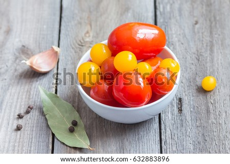 Colorful cherry tomatoes in a white ceramic bowl. Marinated vegetables. #632883896
