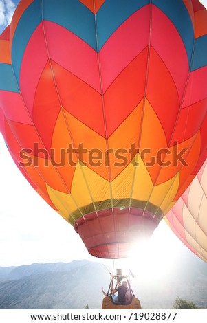 Colorful Chevron Hot Air Balloon Lift Off with Lens Sun Flare at Provo's Balloon Festival #719028877