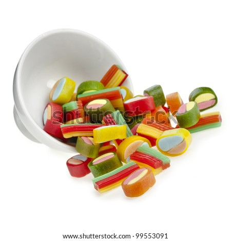 Colorful chewing jelly candy  in a bowl isolated on white