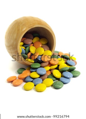 colorful chewy dragees in wooden bowl on a white background #99216794