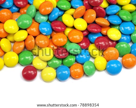 colorful chewy dragees on a white background
