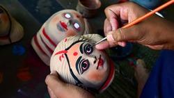 Colorful Chhau (or chhou) masks on making , handicrafts on display at Charida, Purulia, West Bengal, India. Chhau or Chhou is traditional tribal dance festival of India. Selective focus used.
