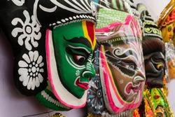 Colorful chhou masks of men on display for sale at handicrafts fair, Kolkata, West Bengal, India.